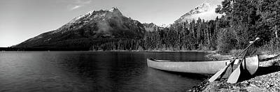 Canoe In Lake In Front Of Mountains Poster