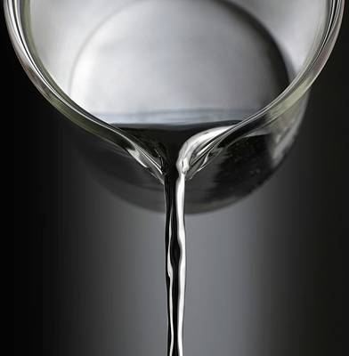 Mercury Pouring From A Beaker Poster by Science Photo Library