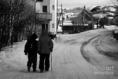 Middle Aged Couple Walking Along Snow Covered Street With Sticks Kirkenes Finnmark Norway Europe Poster