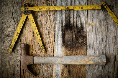 Old Tape Measure And Hammer For Construction On Rustic Wood Back Poster by Brandon Bourdages
