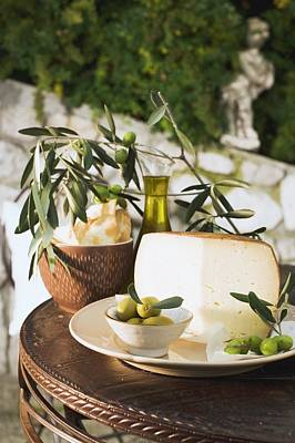 Olives, Cheese, Crackers And Olive Oil On Table Out Of Doors Poster