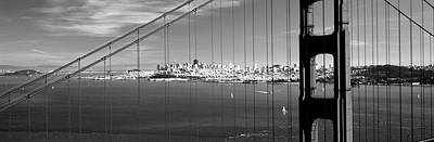 Suspension Bridge With A City Poster by Panoramic Images