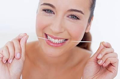Woman Flossing Teeth Poster by Ian Hooton
