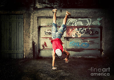 Young Man Jumping On Grunge Wall Poster by Michal Bednarek