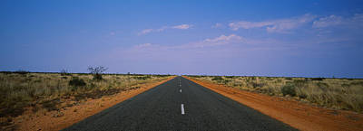 Road Passing Through A Landscape Poster