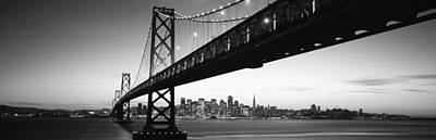 Bridge Across A Bay With City Skyline Poster by Panoramic Images