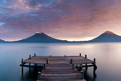 Jetty In A Lake With A Mountain Range Poster