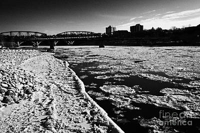 large chunks of floating ice on the south saskatchewan river in winter flowing through downtown Sask Poster by Joe Fox