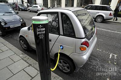 Recharging An Electric Car Poster by Martin Bond