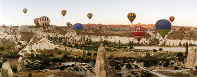 Hot Air Balloons Over Landscape Poster