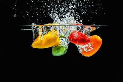 Splashing Paprika Poster by Peter Lakomy