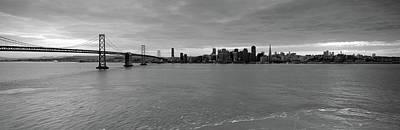 Bridge Across A Bay With City Skyline Poster