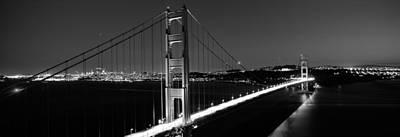 Suspension Bridge Lit Up At Dusk Poster