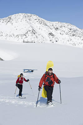 A Backcountry Skier And Snowboarder Get Poster by Dan Bailey