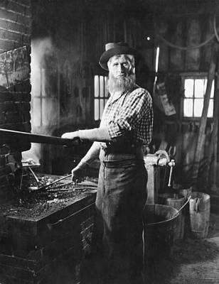 A Blacksmith At His Forge Poster by Underwood Archives