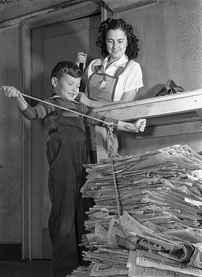 A Boy Recycling Newspaper Poster by Underwood Archives
