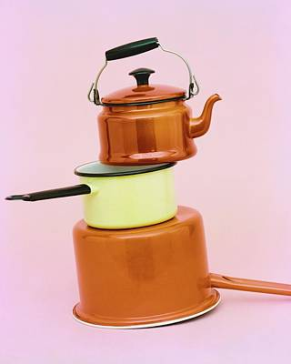 A Brass Teapot Stocked On Top Of Pots Poster by Richard Rutledge