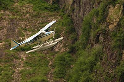 A Bush Pilot Flies His Float Plane Poster by John Alves