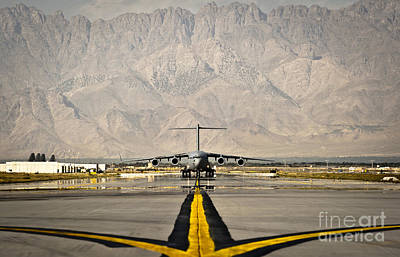 A C-17 Globemaster IIi Taxis Poster by Stocktrek Images