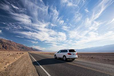 A Car On The Road Near Badwater Poster