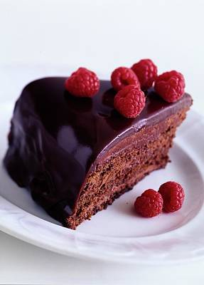 A Chocolate Pecan Cake With Raspberries On Top Poster