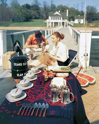 A Clam Bake On A Pier Poster by John Rawlings