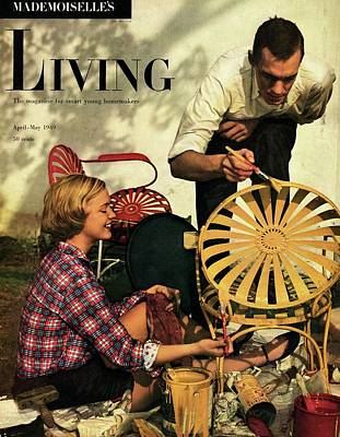 A Couple Painting A Chair Poster by Herman Landshoff