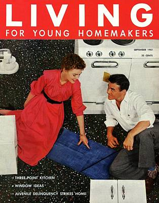 A Couple Sitting On The Kitchen Floor Poster