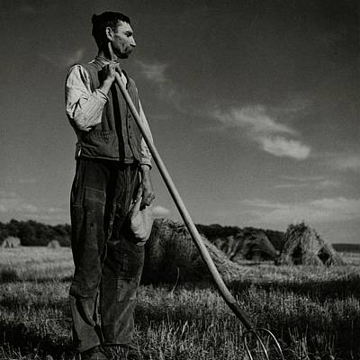 A Farmer Holding A Pitchfork Poster by Roger Schall