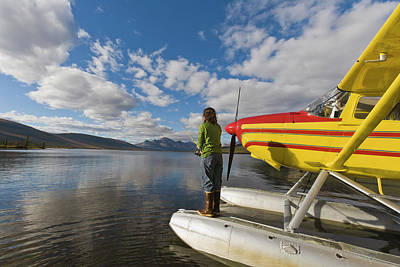 A Fisherman On A Floatplane In Scenic Poster by Hugh Rose
