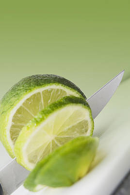 A Knife Cutting A Lime Poster by Marlene Ford