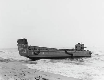 A Landing Craft Beaches To Unload Poster by Stocktrek Images