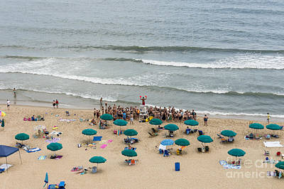 A Lifeguard Gives A Safety Briefing To Beachgoers In Ocean City Maryland Poster