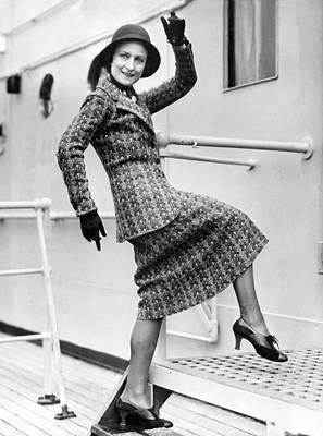 A Lively Woman Boards A Ship Poster by Underwood Archives