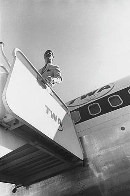 A Male Model Disembarking A Twa Boeing 707 Plane Poster