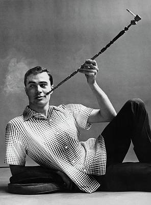 A Male Model Smoking A Cigarette From A Long Pipe Poster