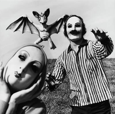 A Man And Woman Wearing Masks With A Bat Flying Poster by Chadwick Hall