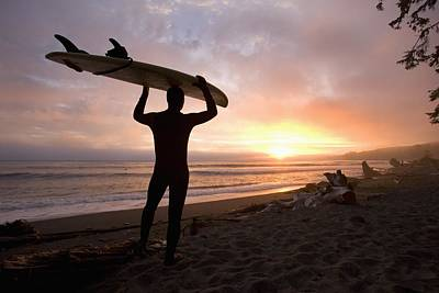 A Man Carrying His Surfboard Sombrio Poster by Deddeda