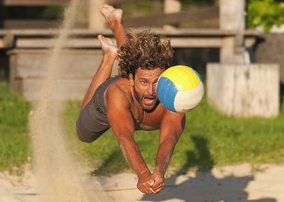 A Man Diving For A Beach Ball Tarifa Poster