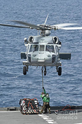 A Mh-60s Sea Hawk Helicopter Lifts Poster