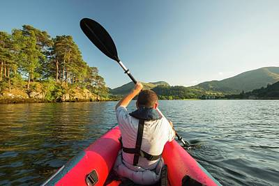 A Middle Aged Man Paddling Poster
