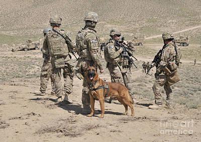 A Military Working Dog Accompanies U.s Poster