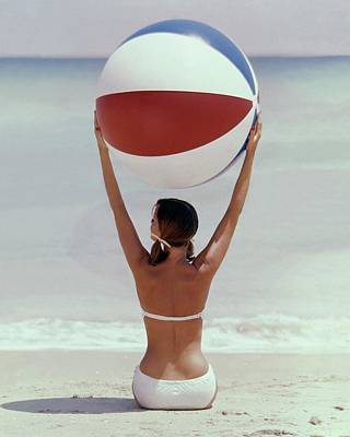 A Model Holding A Beach Ball Poster by Lionel Kazan