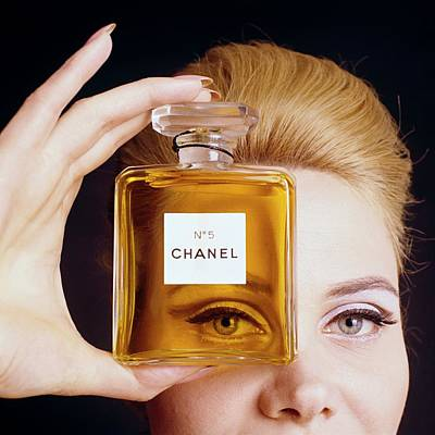 A Model Holding A Bottle Of Perfume Poster by Fotiades