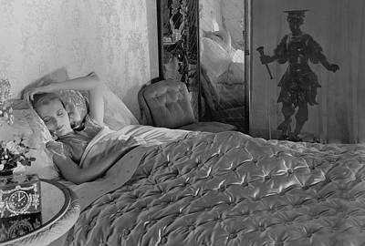 A Model In A Bed With Designer Bedding Poster