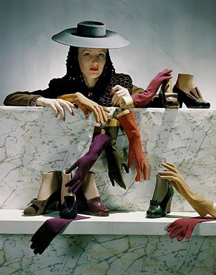 A Model Next To A Shelf Of Assorted Shoes Poster by Horst P. Horst