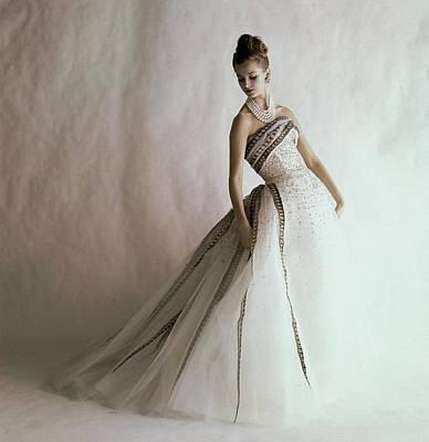 A Model Wearing A Balmain Dress Poster