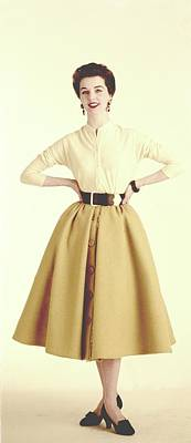 A Model Wearing A Cream Sweater And Camel Skirt Poster