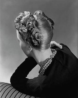 A Model Wearing A Curled Hairstyle Poster by John Rawlings