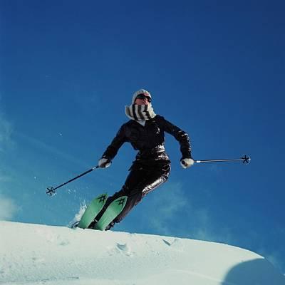 A Model Wearing A Ernst Engel Ski Suit Poster